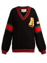 GUCCI Web stripe-intarsia cable-knit wool sweater in black / patch & slogan knitwear