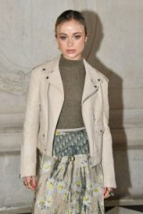 Lady Amelia Windsor at Christian Dior Haute Couture S/S 2019, wearing a taupe daisy print maxi skirt, brown mock neck sweater, cream leather biker jacket and a Dior Oblique Saddle Clutch at dior.com | neutral celebrity outfits | front row celebrities PFW