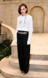 English actress Anna Brewster looks chic in monochrome attending the Chanel show during Paris Fashion Week, January 2019 | celebrity fashion | front row celebrities