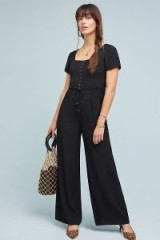 Maeve Shelby Jumpsuit in Black | side corset style ties