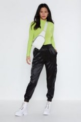 NASTY GAL Cargo Ahead Satin Pants in Black – sporty cuffed trousers