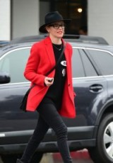 Actress Elizabeth Banks, out in Los Angeles, adding a pop of colour to her casual black outfit with this bright red blazer – celebrity street style January 2019