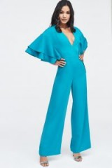 Lavish Alice exaggerated double frill sleeve wide leg jumpsuit in jade green | plunge front going out jumpsuits