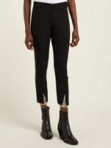 ANN DEMEULEMEESTER Lace-cuff slim-leg black wool trousers
