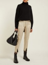 ANN DEMEULEMEESTER Levon cream and black pinstriped satin trousers