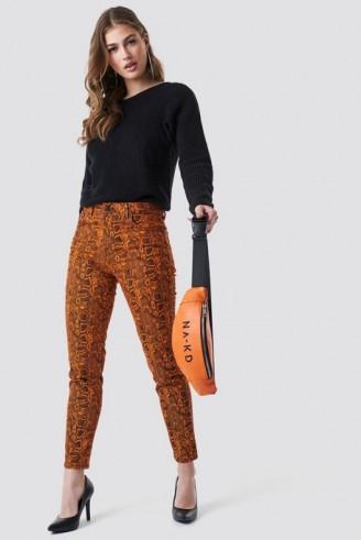NA-KD Neon Snake Skinny Ankle Jeans Orange | reptile print denim