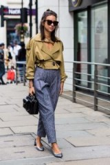 Street style outfits with extra style…light-brown cropped trench, blue high waist trousers, metallic pointy pumps and carrying a black top handle bag