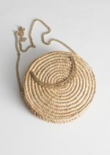 STORIES Woven Straw Crossbody Bag in Beige. ROUND TOP HANDLE BAGS