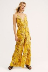 FREE PEOPLE Caicos Jumpsuit in Sundrop | yellow deep V-neckline jumpsuits
