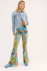 The Janis Printed Bells in Steel Floral. MULTI PRINT RETRO FLARES