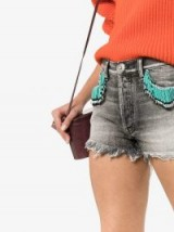 ALANUI fringed denim shorts in Silverlake Wash – faded with frayed hems