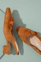 About Arianne Galo Bow-Detailed Suede Heels in Dark Orange | chic retro skingbacks