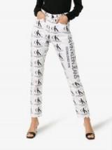 Calvin Klein Jeans Est. 1978 Ok Logo Print High Waist Jeans in White and Black ~ slogan / logo denim