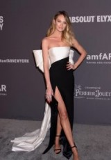 Candice Swanepoel chose a monochrome Rasario bow detail strapless gown for the 2019 amfAR Gala, during New York Fashion Week, 6 February 2019. Celebrity gowns ~ models event dresses