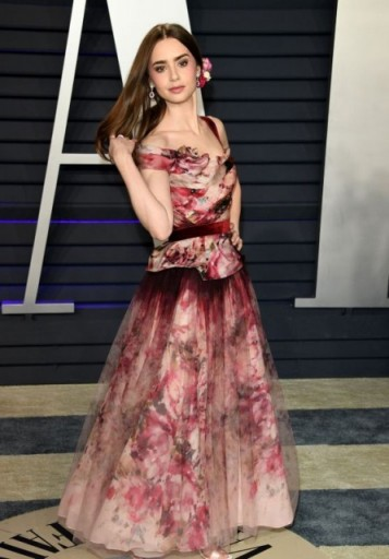 Lily Collins pink gown at the 2019 Oscars afterparty, Marchesa Floral-Print Silk-Blend Peplum Dress, attending the Vanity Fair Oscar Party, 24 February 2019 | celebrity red carpet gowns