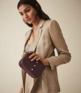 REISS MINI JESSIE LEATHER TASSEL CROSS BODY BAG BERRY ~ stylish crossbody
