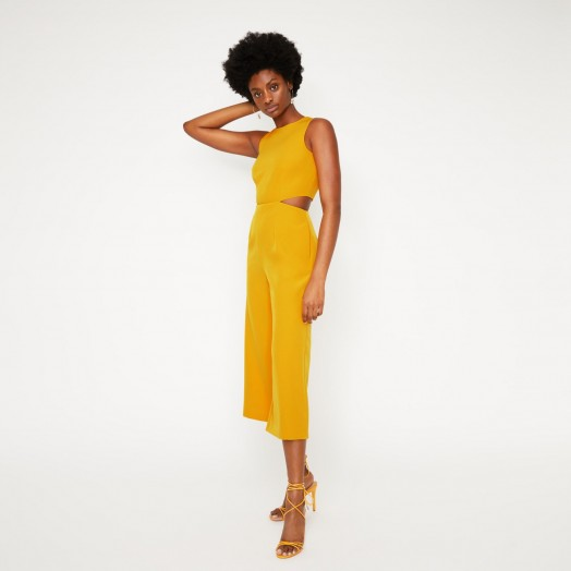 WAREHOUSE OPEN BACK CULOTTE JUMPSUIT IN YELLOW / colours for spring fashion