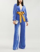 SILVIA TCHERASSI Eleanor bow-detail velvet flared jumpsuit in blue hydrangea | statement jumpsuits