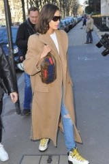 Olivia Culpo white walking boots with yellow laces, PROENZA SCHOULER chunky hiking boots, in Paris, 25 February 2019 | celebrity footwear