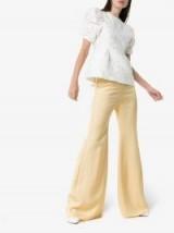 Aleksandre Akhalkatsishvili High-Waisted Flared Trousers / pastel-yellow flares