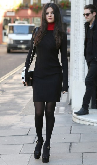 Selena gomez looked chic while out and about, in this simple black knitted dress by Edun, and a pair of peep toe platform shoes, 23 September 2015. Celebrity fashion | designer dresses | star style