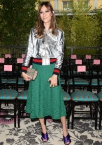Gia Coppola attended the Gucci S/S 2016 show at MFW, wearing a Gucci silver crackle leather bomber jacket, Cluny emerald green lace skirt and Sylvia purple satin crossover sandals, all from gucci.com. Celebrity fashion – designer clothing – front row outfits