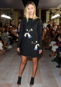Model Natasha Poly in a black long sleeve shift dress and peep toe booties at Roberto Cavalli S/S 2016. Front Row celebrities / celebrity style / Milan Fashion Week / outfits