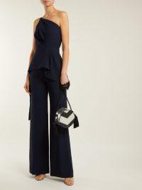 ROLAND MOURET Charlesworth asymmetric peplum crepe jumpsuit | Matches Fashion
