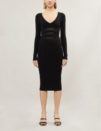 GOOD AMERICAN Panelled asymmetric stretch-knit dress in black | fitted LBD