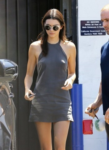 Kendall Jenner looked casual wearing this cute halterneck mini dress from NBD, leaving a production studio in Van Nuys, California, 28 August 2015. Don't Turn Back Dress available from revolveclothing.com. Celebrity fashion | star style | day dresses
