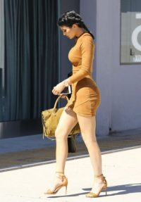 Kylie Jenner out and about in LA, wearing a tan bodycon dress from mistressrocks.com and ankle strap sandals, 29 September 2015. Celebrity fashion | style icons | Jenner's outfits