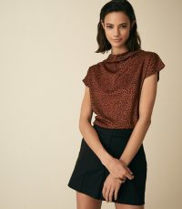 PAX PRINTED HIGH NECK TOP RUST/BLACK | chic brown spot print tops