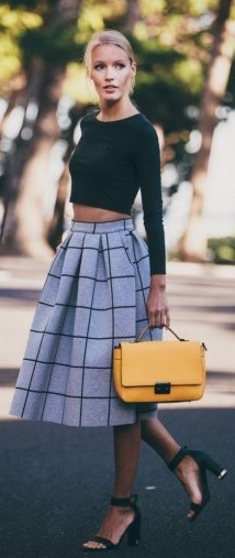 Street style chic…black long sleeved crop top, grey & black check midi skirt, black mid heel ankle strap shoes & yellow handbag for a pop of colour. Style inspiration   stylish day outfits - flipped