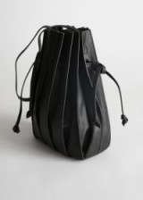 STORIES Pleated Leather Bucket Bag in Black | drawstring bags