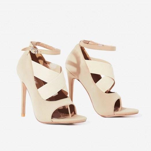 EGO Yara Caged Elasticated Peep Toe Heel In Nude Lycra ~ cross front party heels - flipped