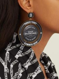 BALENCIAGA Casino logo-print drop earrings | Matches Fashion