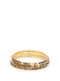 CHLOÉ Set of three slogan-embossed bracelets | gold tone designer bangles