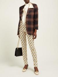 GUCCI Stirrup-print stretch cotton-blend skinny jeans | Matches Fashion