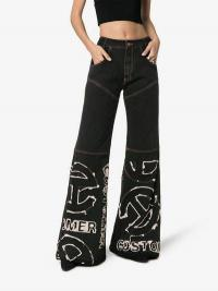 Telfar Contrast Logo Stitched Flared Jeans in Black