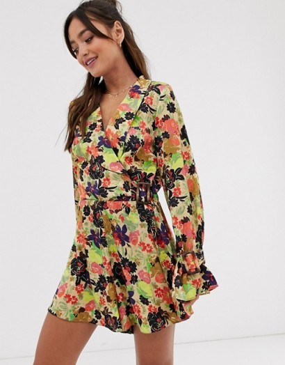 ASOS DESIGN 70s floral print frill hem playsuit / wrap style playsuits