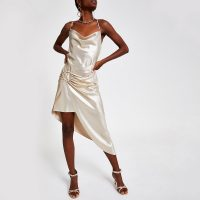 RIVER ISLAND Gold asymmetric slip dress.