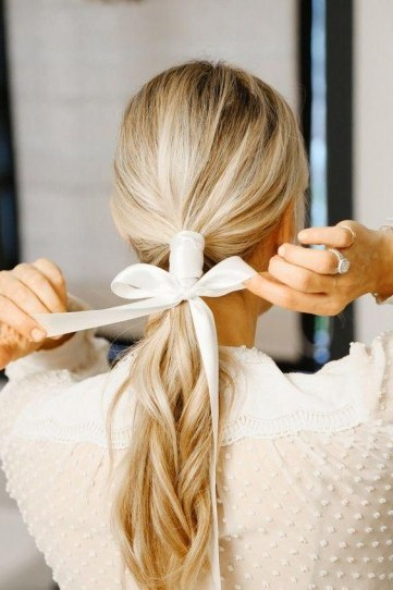 Ponytail tied with ribbon - flipped