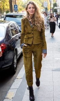 Blake Lively street style wearing a green outfit of slim trousers, matching jacket and combat boots