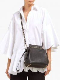 VALENTINO Rockstud drawstring black grained leather cross-body bag / chic crossbody