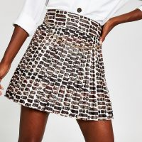 River Island Beige RI print pleated mini skirt