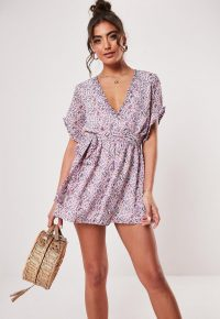 Missguided pink floral ruffle tie waist playsuit | floaty plunge front playsuits
