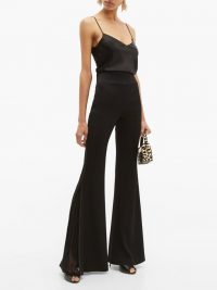GALVAN Ray plissé-inset kick-flare trousers | black party pants | vintage style evening fashion
