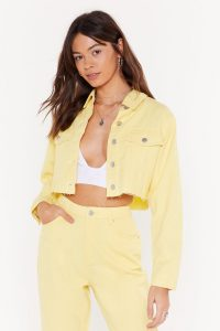 Nasty Gal We Can't Be Cropped Denim Jacket in Lemon | raw hem jackets