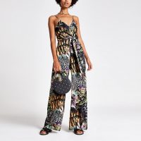 RIVER ISLAND Black mixed print knot front jumpsuit.