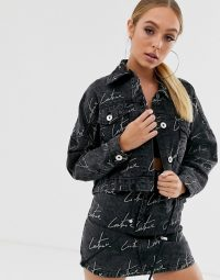 The Couture Club cropped motif denim jacket in washed black | logo print jackets